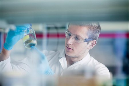 equipment - Young male scientist working in a pharmacy laboratory, Freiburg Im Breisgau, Baden-Württemberg, Germany Stock Photo - Premium Royalty-Free, Code: 6121-08522343