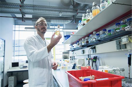 Young scientist working in a pharmacy laboratory, Freiburg im Breisgau, Baden-Württemberg, Germany Stock Photo - Premium Royalty-Free, Code: 6121-08522393