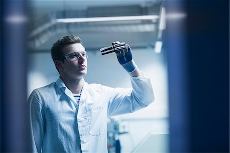 equipment - Young male scientist working in an optical laboratory, Freiburg Im Breisgau, Baden-Württemberg, Germany Stock Photo - Premium Royalty-Free, Code: 6121-08522451