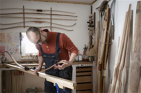 Male bow maker making bow in workshop, Bavaria, Germany Stock Photo - Premium Royalty-Free, Code: 6121-08660286