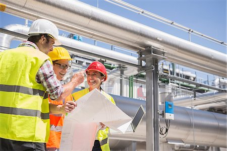 Engineer and workers in meeting on the area of a geothermal power station, Bavaria, Germany Stock Photo - Premium Royalty-Free, Code: 6121-08859265