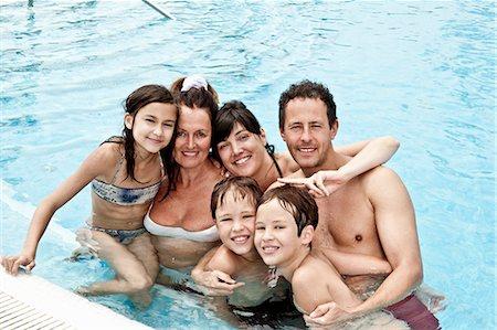 Family portrait in pool Stock Photo - Premium Royalty-Free, Code: 6122-07692796