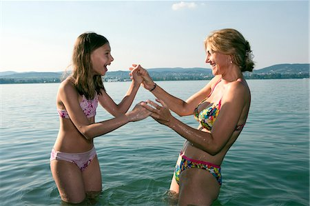 Mother and daughter playing in lake Stock Photo - Premium Royalty-Free, Code: 6122-07693618
