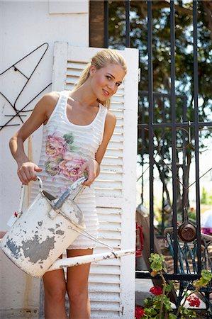 Girl watering flowers Stock Photo - Premium Royalty-Free, Code: 6122-07693858