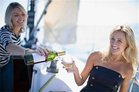 sailboat  ocean - Women drinking wine on boat Stock Photo - Premium Royalty-Free, Code: 6122-07694041