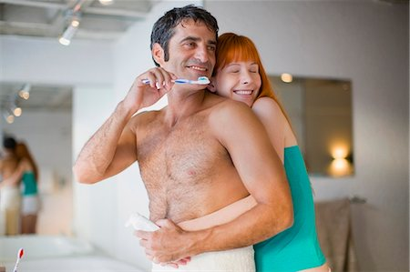 Couple hugging in bathroom Stock Photo - Premium Royalty-Free, Code: 6122-07694013