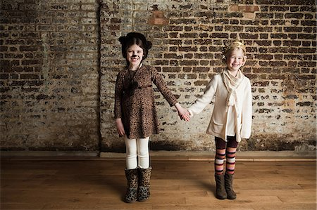 preteen girl pussy - Young girls dressed up as cat and queen, holding hands Stock Photo - Premium Royalty-Free, Code: 6122-07694477