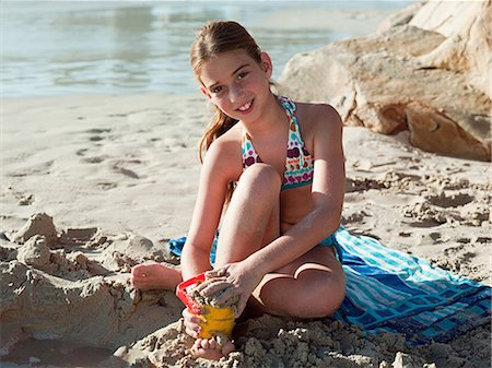 Girl on a beach Stock Photo - Premium Royalty-Free, Code: 6122-07694582