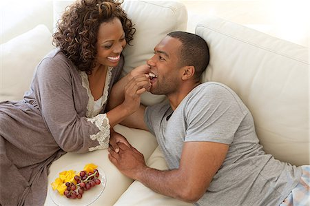 Woman feeding grapes to boyfriend Stock Photo - Premium Royalty-Free, Code: 6122-07695595