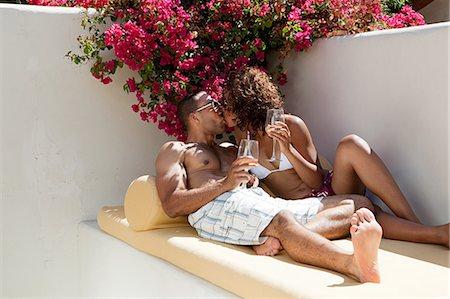 sexy black women in bikinis - Relaxed couple kissing Stock Photo - Premium Royalty-Free, Code: 6122-07695601