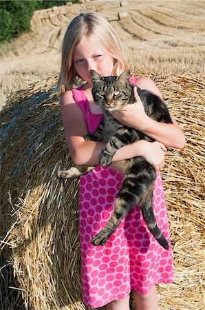 preteen girl pussy - Girl holding cat, portrait Stock Photo - Premium Royalty-Free, Code: 6122-07696747