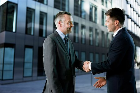 Businessmen shaking hands Stock Photo - Premium Royalty-Free, Code: 6122-07697163