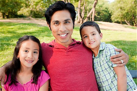 filipino ethnicity - Man with son and daughter in park, portrait Stock Photo - Premium Royalty-Free, Code: 6122-07697505