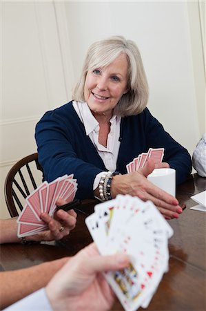 Mature woman playing cards Stock Photo - Premium Royalty-Free, Code: 6122-07697873