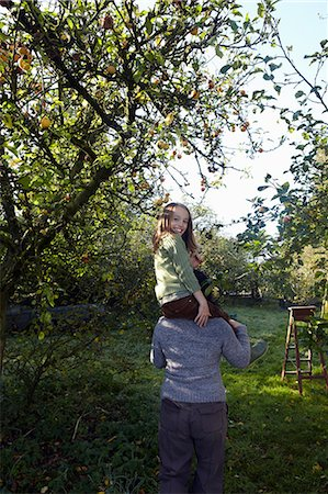 family apple orchard - Girl on mother's shoulders in orchard Stock Photo - Premium Royalty-Free, Code: 6122-07698008