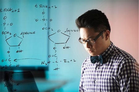 filipino (male) - Young man with diagram on window Stock Photo - Premium Royalty-Free, Code: 6122-07698176