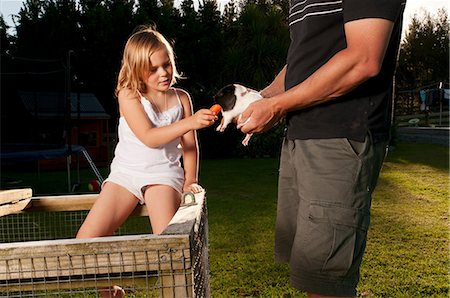 Girl feeding guinea pig Stock Photo - Premium Royalty-Free, Code: 6122-07698205