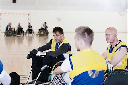 disable exercising - Para rugby team talking during time-out Stock Photo - Premium Royalty-Free, Code: 6122-07700099