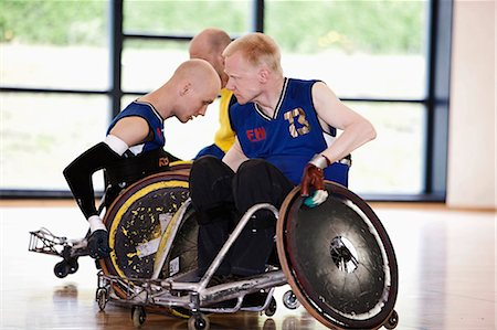 disable exercising - Para rugby players playing rugby Stock Photo - Premium Royalty-Free, Code: 6122-07700107