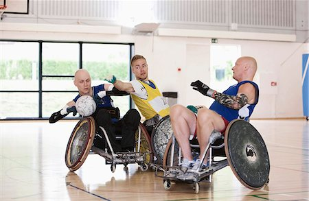 disable exercising - Para rugby players playing rugby Stock Photo - Premium Royalty-Free, Code: 6122-07700104