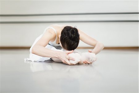 Ballet dancer stretching in studio Stock Photo - Premium Royalty-Free, Code: 6122-07700267
