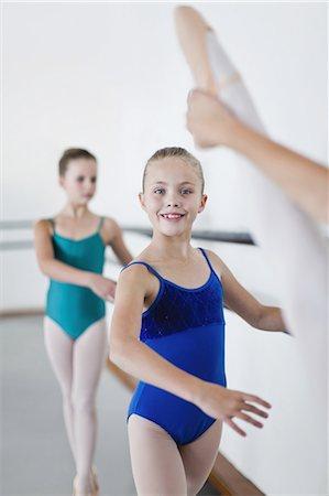 preteen dancing - Ballet dancers posing at barre Stock Photo - Premium Royalty-Free, Code: 6122-07700322