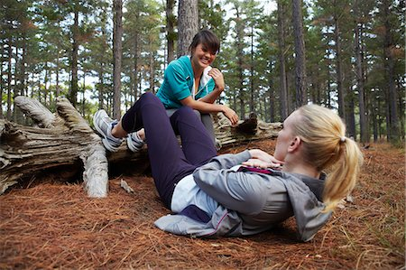 Women exercising together in forest Stock Photo - Premium Royalty-Free, Code: 6122-07700498