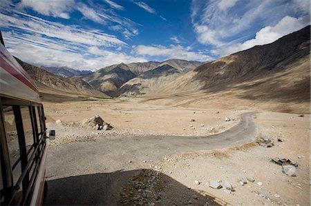 Rural road through desert and mountains Stock Photo - Premium Royalty-Free, Code: 6122-07700619