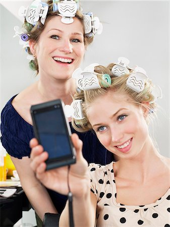 Women photographing themselves in salon Stock Photo - Premium Royalty-Free, Code: 6122-07700712