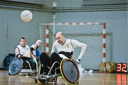 disable exercising - Men in wheelchairs playing pararugby Stock Photo - Premium Royalty-Free, Code: 6122-07701182