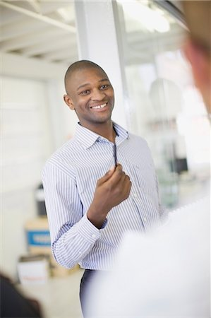 filipino (male) - Businessman talking in office Stock Photo - Premium Royalty-Free, Code: 6122-07701461
