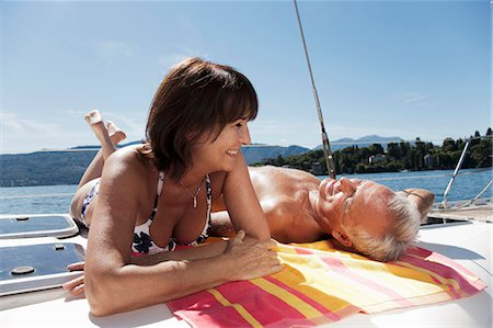 Older couple relaxing on sailboat Stock Photo - Premium Royalty-Free, Code: 6122-07701406