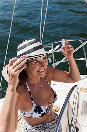 Woman relaxing on sailboat Stock Photo - Premium Royalty-Free, Code: 6122-07701409