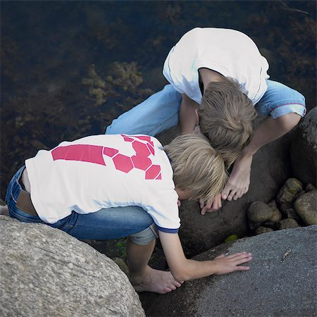 Boys playing in river Stock Photo - Premium Royalty-Free, Code: 6122-07701778