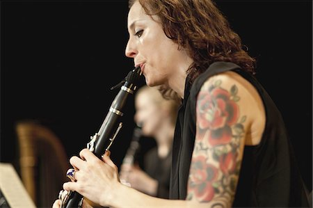 Clarinet player in orchestra Stock Photo - Premium Royalty-Free, Code: 6122-07702086