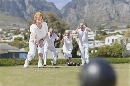 Older couples playing lawn bowling Stock Photo - Premium Royalty-Free, Code: 6122-07702127