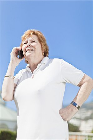 Older woman talking on cell phone Stock Photo - Premium Royalty-Free, Code: 6122-07702130