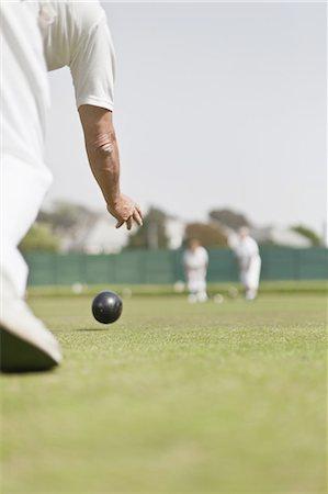 Older man lawn bowling Stock Photo - Premium Royalty-Free, Code: 6122-07702131