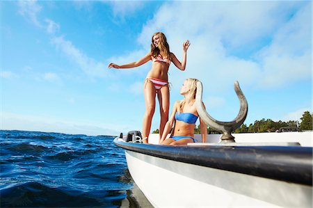 Teenage girls relaxing on sailboat Stock Photo - Premium Royalty-Free, Code: 6122-07702242