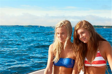 Teenage girls relaxing on sailboat Stock Photo - Premium Royalty-Free, Code: 6122-07702244