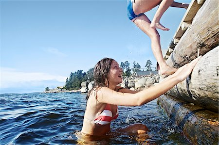 Teenage girls climbing pier Stock Photo - Premium Royalty-Free, Code: 6122-07702225