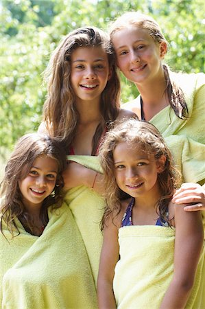 preteen swim - Girls wrapped in towels after swimming Stock Photo - Premium Royalty-Free, Code: 6122-07702582