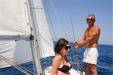 Older couple sailing on lake Stock Photo - Premium Royalty-Free, Code: 6122-07702767