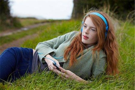 red hair preteen girl - Teenage girl listening to headphones Stock Photo - Premium Royalty-Free, Code: 6122-07702711