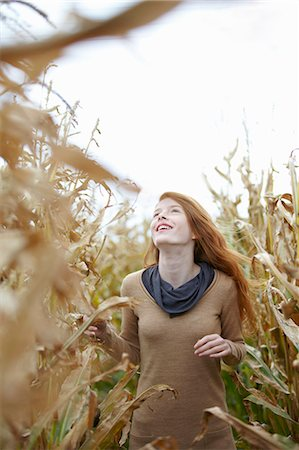 red hair preteen girl - Teenage girl walking in cornfield Stock Photo - Premium Royalty-Free, Code: 6122-07702716