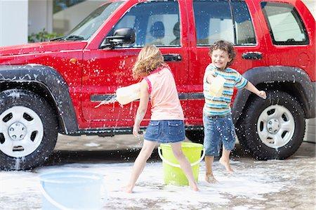 Children playing and washing car Stock Photo - Premium Royalty-Free, Code: 6122-07703083