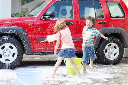 Children playing and washing car Stock Photo - Premium Royalty-Free, Code: 6122-07703083