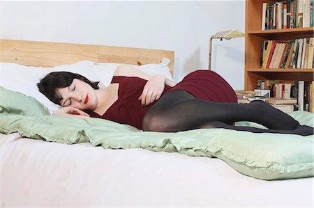 Woman sleeping on bed Stock Photo - Premium Royalty-Free, Code: 6122-07703198
