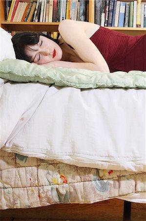 Woman sleeping on bed Stock Photo - Premium Royalty-Free, Code: 6122-07703199