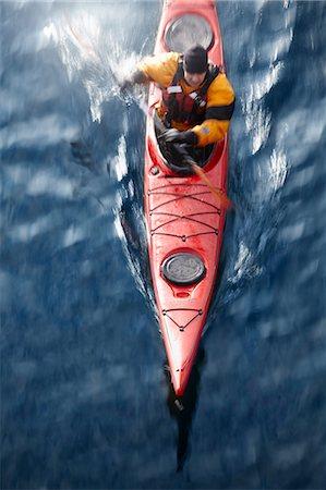 Aerial view of kayaker in water Stock Photo - Premium Royalty-Free, Code: 6122-07703270
